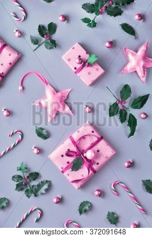 Toned Two Tone Duochrome Christmas Background With Pink Gift Boxes, Stripy Candy Canes, Trinkets And