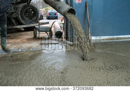 Builders Poured Concrete At The Construction Site