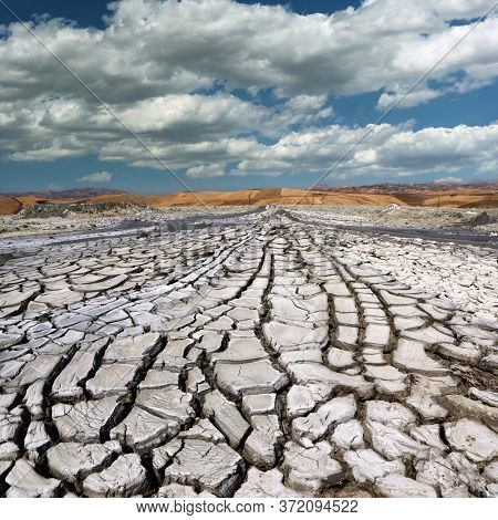 mud dried and cracked of Macalube volcanoes is natural landmark of Sicily tourism