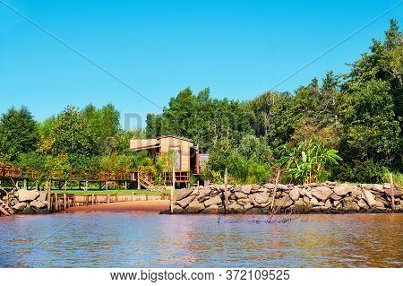 Lush Vegetation, Wooden House And Boat Pier. Tigra Delta In Argentina, River System Of The Parana De