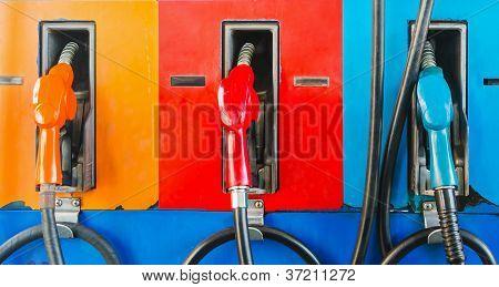 colorful fuel oil gasoline dispenser at petrol filling station poster