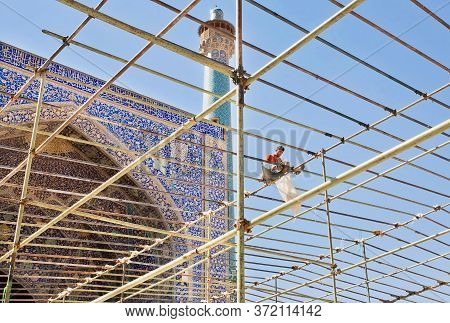Isfahan, Iran: Persian Mosque In Time Of Repair Works, With Scaffolding Worker Over Imam Mosque On 1