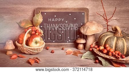 Autumn Traditional Decorations, Toned Panoramic Image. Text Happy Thanksgiving On Blackboard. Fall L