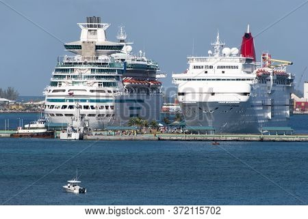 Two Large Cruise Liners Moored In Nassau, The Most Popular Port Of Call In Caribbean (bahamas).