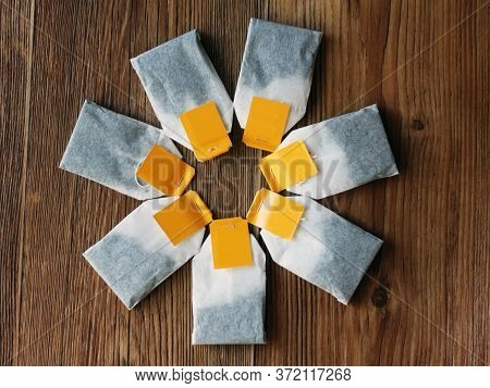 Tea Bags On Wooden Table. Top View Object.