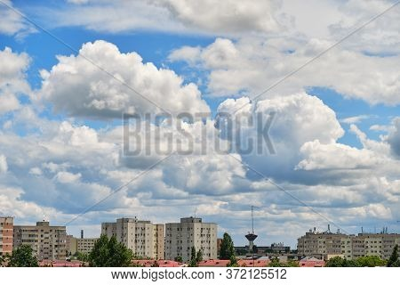 Stratocumulus Clouds Form A Layer And Move Fast From Left To Right Over City Buildings, In A Residen