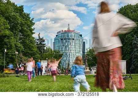 Bucharest, Romania - June 1, 2020: People Enjoying A Sunny Day In Herastrau Park, Sitting Down In Gr
