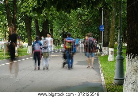 Unrecognizable People On A Busy Sidewalk In Bucharest, Romania, After Coronavirus (covid-19) Restric