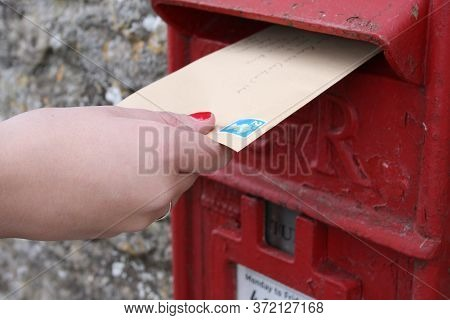 Someone Posting A Stamped Letter In A Post Box In Oxfordshire In The Uk On The 28th October 2008