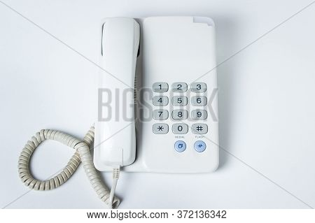 Landline Phone On A White Background. White Landline Phone With Buttons