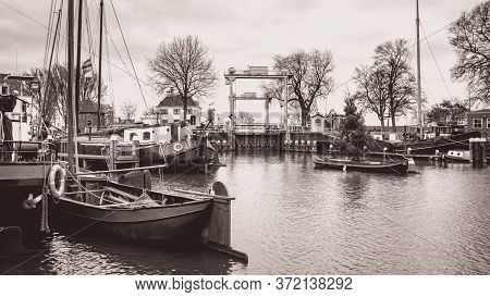 Gouda, Netherlands, December 23 2015: The Museum Harbor Of Gouda In The Netherlands With Monumental