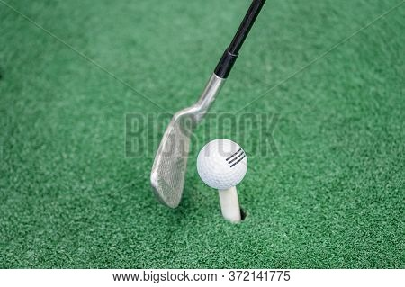 Swing A Golf Club To Hit The Ball