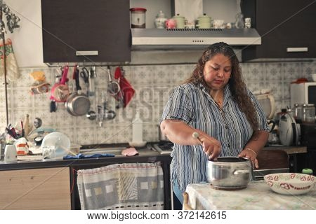 woman in the kitchen prepares lunch