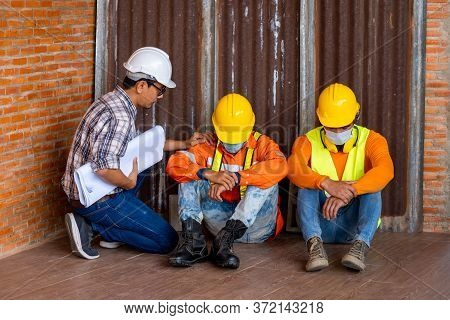 Engineer Group Unemployed Stress Sitting In Construction Site After Experiencing Problems Despair Lo
