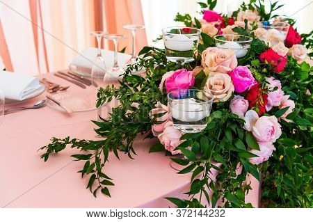 Flowers And Candles On The Table Setting At A Banquet On The Table With Serving And Table Setting Fo