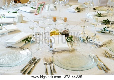 Table Setting At A Banquet On The Table With Serving And Table Setting For A Reception Before A Larg