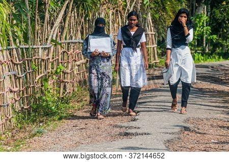 Bagerhat, Bangladesh - November 16, 2016: Muslim School Girls Walking On A Road In Bagerhat, Banglad