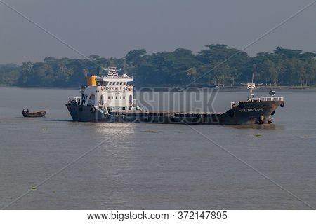 Morrelganj, Bangladesh - November 19, 2016: Mv Newtek Cargo Ship On Pangunchi River Near Morrelganj
