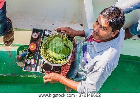 Hularhat, Bangladesh - November 19, 2016: Seller Of Paan Betel Leaf With Areca Nut On A Ship, Bangla