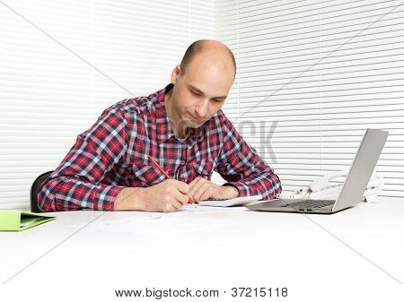 Young Man Working At Office