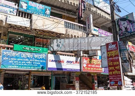 Sonargaon, Bangladesh - November 21, 2016: Houses Covered Under Advertisments In Sonargaon Town, Ban
