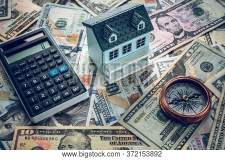 model house on us banknotes background.