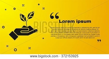 Black Plant In Hand Of Environmental Protection Icon Isolated On Yellow Background. Seed And Seedlin