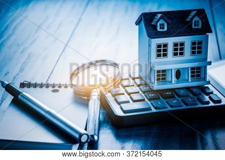 Miniature House  on keyboard at desk.