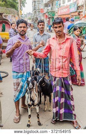 Dhaka, Bangladesh - November 22, 2016: Local Men With Their Goats In Old Dhaka, Bangladesh