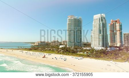 Miami Beach On A Bright Sunny Day, Aerial View. Drone Flying Forward Near Miami Beach, South Beach,