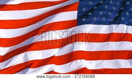 Full Frame: Usa American Flag Background Texture. American Flag Background Waving In The Wind. Close