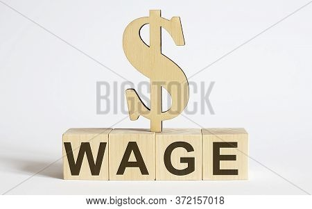 Text Wage On Wood Cube Block, Stock Investment Concept.