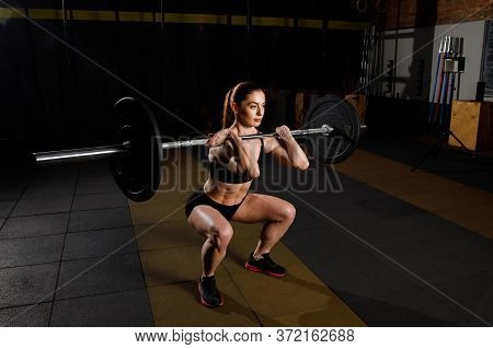 Woman With Barbell Caucasian Female Performing Deadlift Exercise With Barbell. Healthy Lifestyle