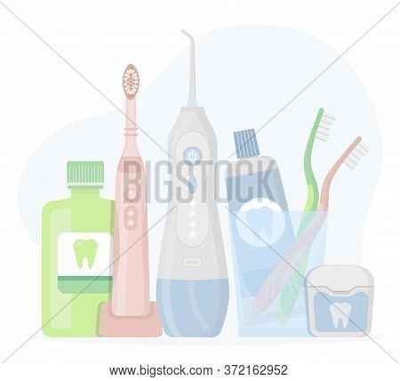 Electric Toothbrush, Toothpaste In A Glass, Floss, Oral Irrigator, Waterpick, Mouthwash On White Bac