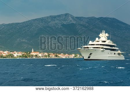 Luxury Super Yacht Passing Korcula Island In Adriatic, Croatia