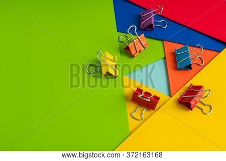 colorful paper with clips, still life