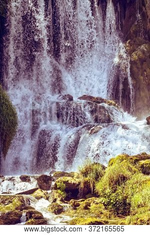 Kravice Waterfall On The Trebizat River In Bosnia And Herzegovina In Autumn. Miracle Of Nature In Bo