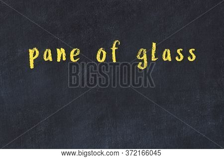 Chalk Handwritten Inscription Pane Of Glass On Black Desk