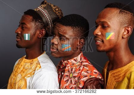 Concept Of Friendship Between Countries: 3 Afro-american Men In National Clothes From Different Coun