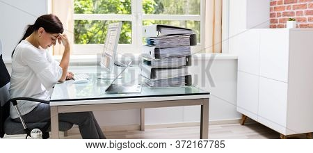 Frustrated Workaholic Woman At Computer Desk. Professional Businesswoman