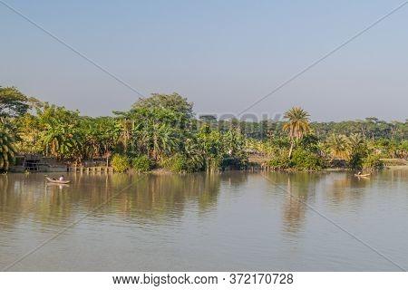 Sandha River, Bangladesh - November 19, 2016: Fishermen On Small Boats On Sandha River, Bangladesh