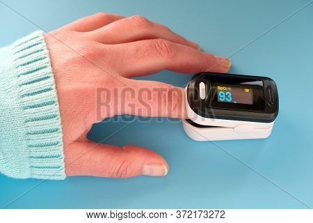 Pulse Oximeter Portable Digital Device To Measure Persons Oxygen Saturation. Reduction In Oxygenatio