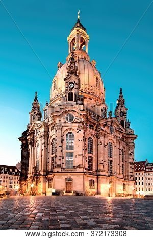 Illuminated Church Of Our Lady, Or Frauenkirche, At Night In Dresden, Germany, On A Quiet Evening Wi