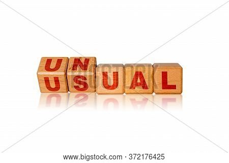 Concept Of The Word Unusual Displayed In Unconventional Way By Use Of Alphabet Blocks. Business As U
