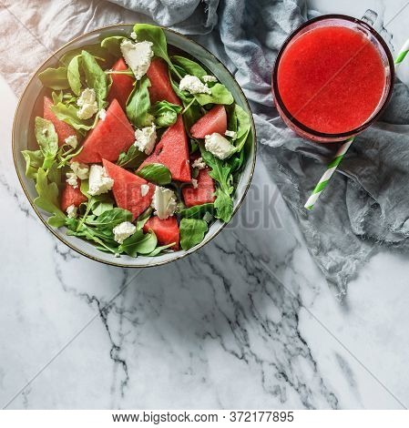 Fresh Summer Watermelon Salad With Feta Cheese, Arugula, Spinach And Greens With Smoothie On Light M