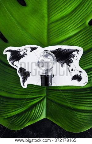 Ideas For Ecology And The Environment Concept, Lightbulb And World Map On Top Of Tropical Leaf