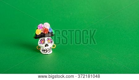 A Catrina La Calavera Garbancera , Dapper Skeleton, Elegant Skull On A Green Background. Mexican Cul