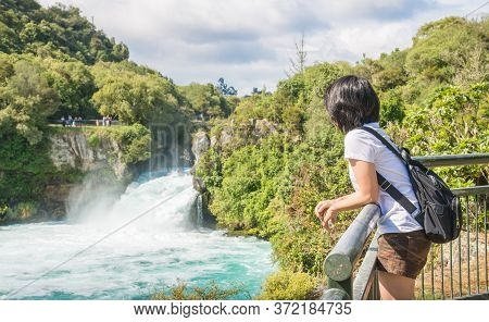 Asian Woman Traveling And Looking To The Spectacular View Of Huka Falls Is New Zealand's Most Visite
