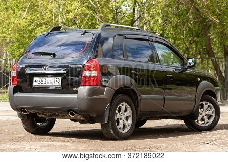 Novosibirsk/ Russia - May 02 2020: Black Hyundai Tucson, Popular Jeep  Car Parked Outdoors On A Warm