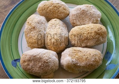 Deep-frozen Arancini Rice In A Dish Ready To Be Fried